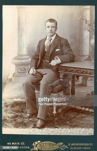 Cabinet card showing a young man wearing a formal wool blazer and waistcoat, striped dress trousers and a striped neck tie, Glasgow, Scotland, circa...