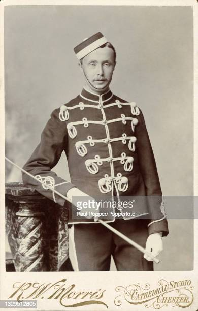 Cabinet card showing a young man wearing the military uniform of the 11th Hussars, he wears full dress tunic with frogging, a pillbox forage cap and...