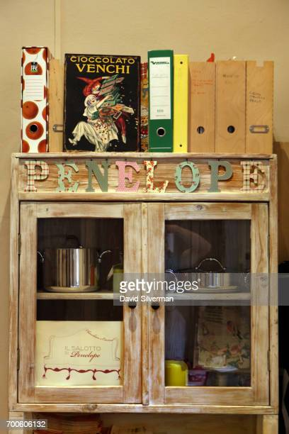 A cabinet holds cooking pots and recipe folders at Il Salotto di Penelope on March 30 2017 in Bologna Italy Il Salotto di Penelope is a private...
