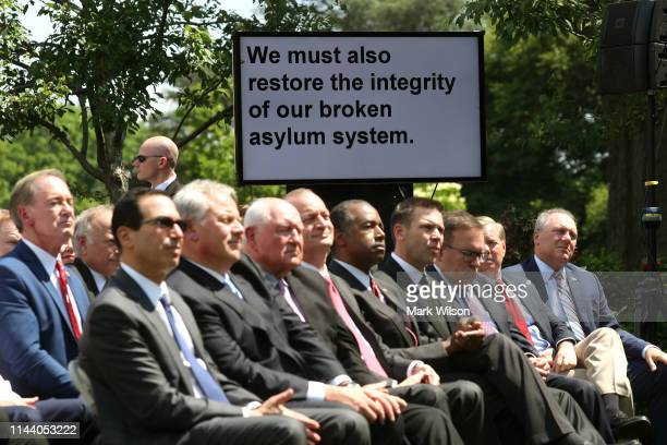 Cabinet members and Senators sit in front of the teleprompter as U.S. President Donald Trump speaks about immigration reform in the Rose Garden of...