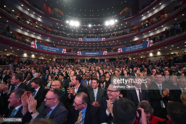Cabinet members applaud as Prime Minister Theresa May speaks during the Conservative Party Conference on October 3 2018 in Birmingham England Theresa...