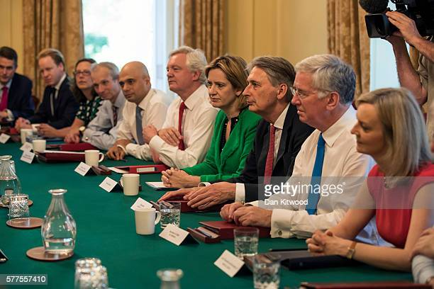 Cabinet members including Home Secretary Amber Rudd and Chancellor of the Exchequer Philip Hammond listen to British Prime Minister Theresa May as...