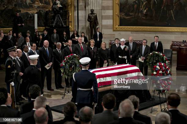 Cabinet members of the US President Donald Trump administration pay their respects as former President George W Bush lies in state at the Capitol...