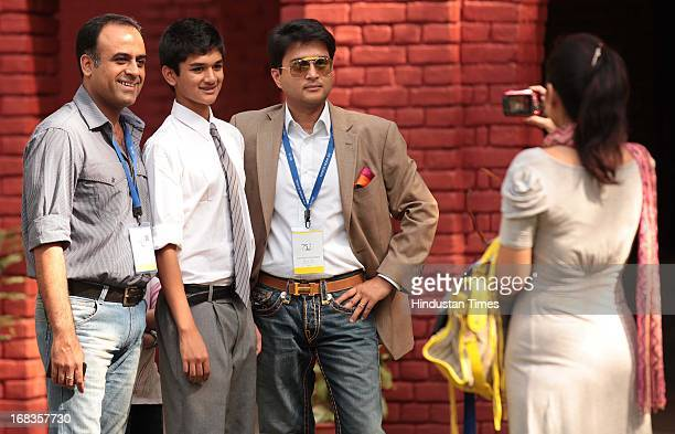 Cabinet Minister Jyotiraditya Madhavrao Scindia with his son Aryaman Scindia and friend Puneet Sharma poses for a picture while his wife tries to...