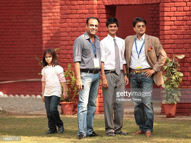 Cabinet Minister Jyotiraditya Scindia with his son Aryaman Scindia and friend Puneet Sharma poses for a picture while his wife tries to capture them...