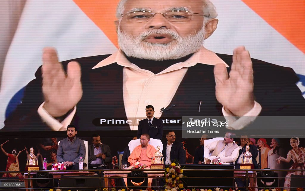 Cabinet Minister of Youth Affairs and Sports Rajyavardhan Singh Rathore, Uttar Pradesh Chief Minister Yogi Adityanath and Dr. Mahesh Sharma (Union Minister of State for Tourism & Culture (Independent Charge) listening Prime Minister Narendra Modis inaugural speech through video conferencing of 22nd National Youth Festival at Gautam Buddha University , on January 12, 2018 in Greater Noida, India.