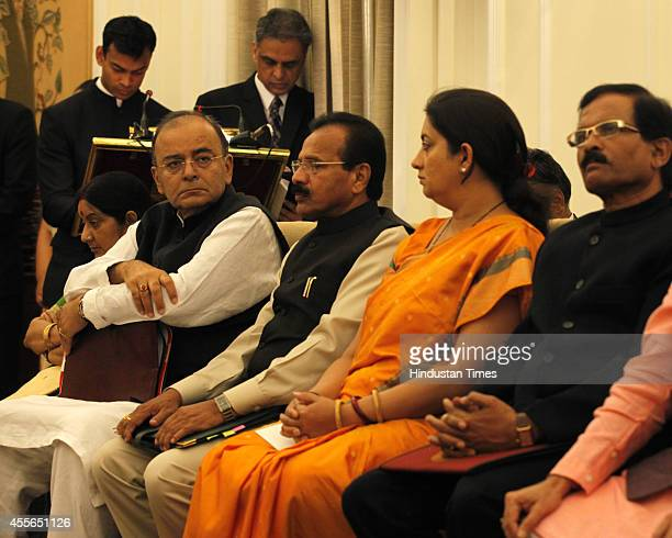 Cabinet Ministers Arun Jaitley Sadanand Gowda and Smriti Irani at the agreement signing ceremony at Hyderabad House on September 18 2014 in New Delhi...