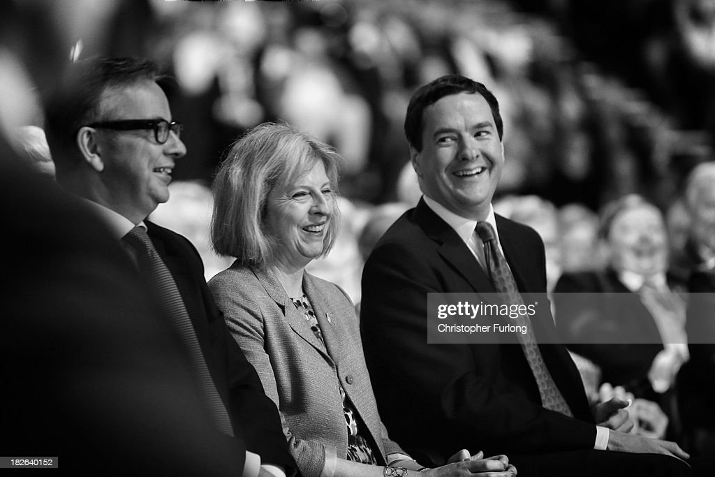 Cabinet Ministers Michael Gove (L), Theresa May and George Osborne laugh as British Prime Minister David Cameron delivers his keynote speech to delegates on the last day of the annual Conservative Party Conference at Manchester Central on October 2, 2013 in Manchester, England. During his closing speech David Cameron said that his 'abiding mission' would make the UK into a 'land of opportunity'.