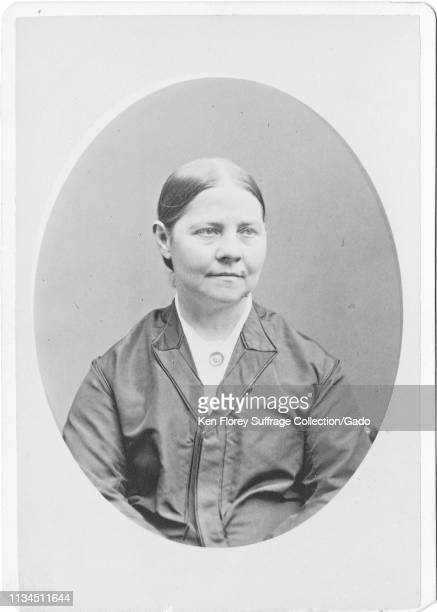 Cabinet photo with a portrait from the waist up of suffragist and abolitionist Lucy Stone with a relaxed expression on her face photographed by...