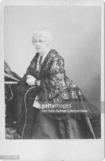 Cabinet photo with a threequarter length portrait in partial profile of suffragist and abolitionist Elizabeth Cady Stanton with a serious expression...