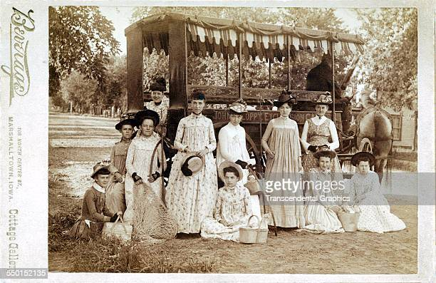 Cabinet photograph by Beverege of a group of young women out for a trip in a horsedrawn surrey Marshalltown Iowa circa 1885