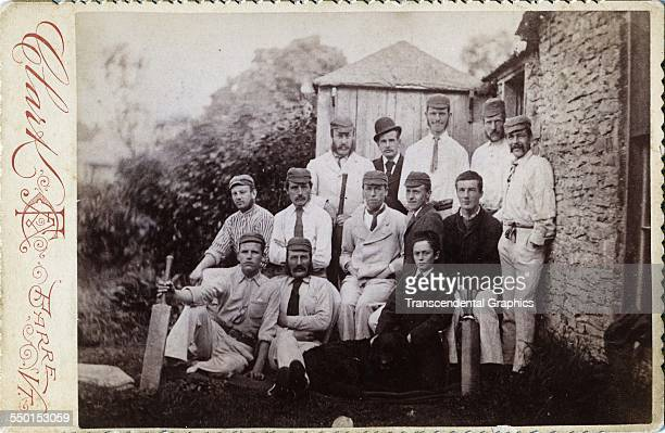 Cabinet photograph by Clark shows a cricket team posed in uniform in the countryside Barre Vermont circa 1885
