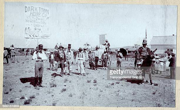 Cabinet photograph of a group of celebrants in racist blackface costumes Elbert County Colorado circa 1890s
