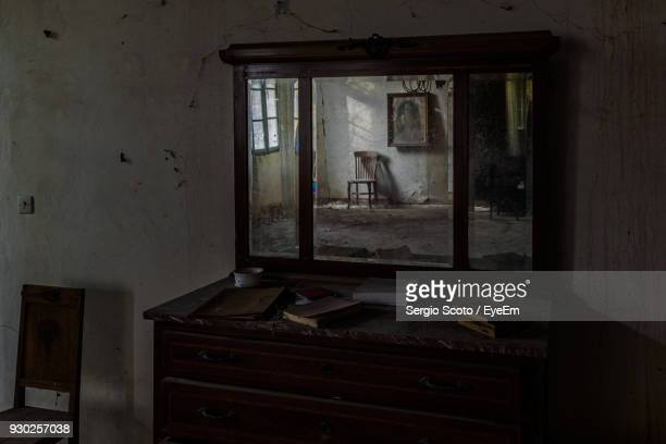 Cabinet With Mirror In Abandoned Room