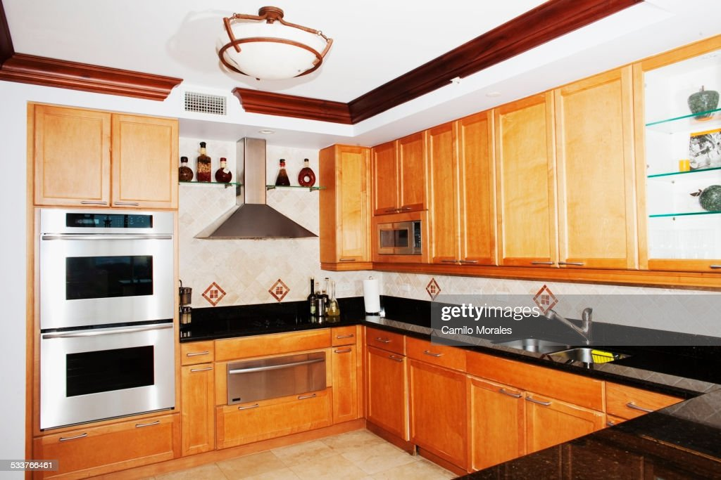 Cabinets and countertops in modern kitchen : Foto stock