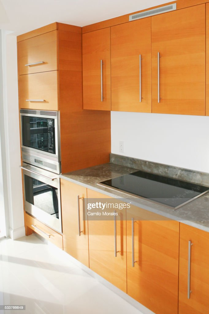 Cabinets, counters and stove in modern kitchen : Foto stock