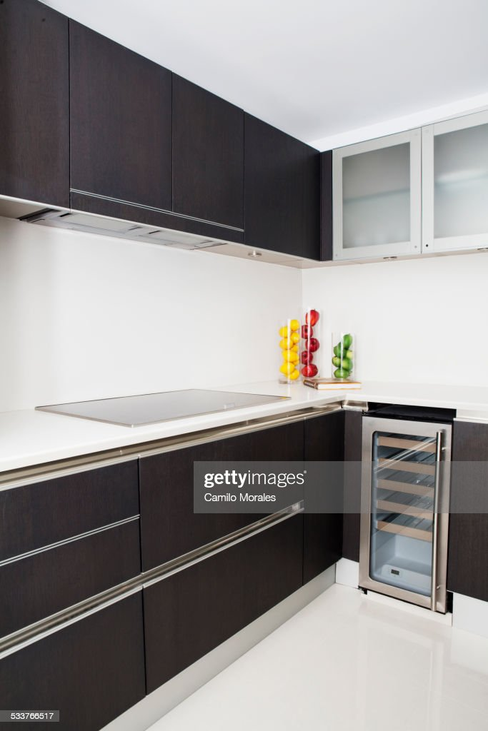 Cabinets, stove and miniature refrigerator in modern kitchen : Foto stock