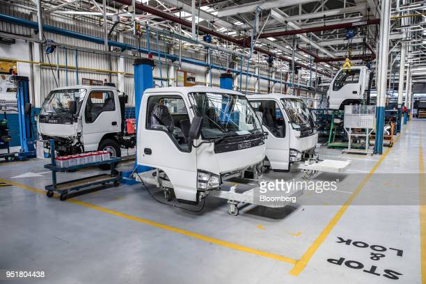Cabins for Isuzu NPR NSeries trucks stand on the assembly line inside the Isuzu East Africa Ltd plant in Nairobi Kenya on Thursday April 26 2018...