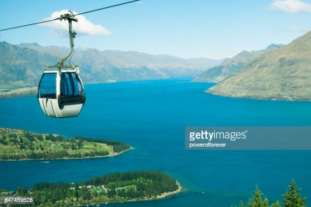 cable car above queenstown in the remarkable mountains of new zealand - cable car stock pictures, royalty-free photos & images