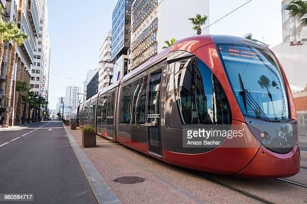 cable car amidst buildings in city - casablanca photos et images de collection