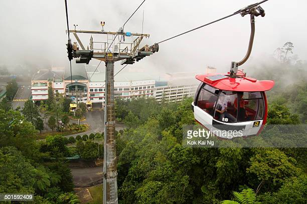 CONTENT] A cable car ascends from the Genting Skyway Station at Gohtong Jaya heading above clouds