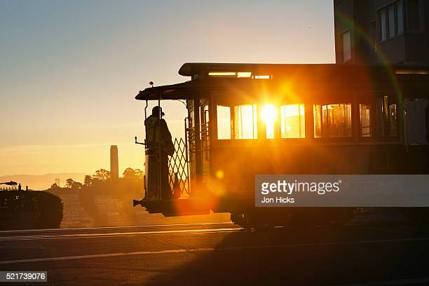 cable car at dawn. - san francisco california stock pictures, royalty-free photos & images