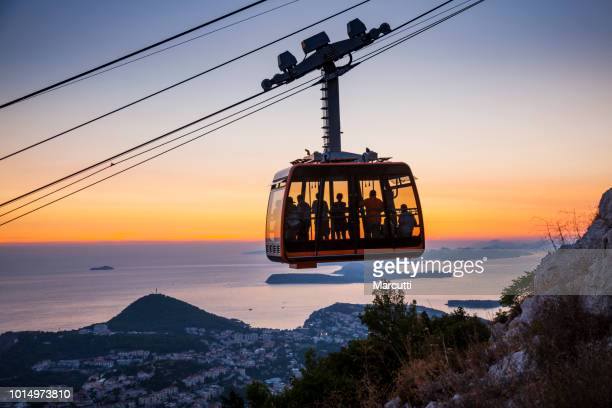 cable car at sunset - overhead cable car stock pictures, royalty-free photos & images