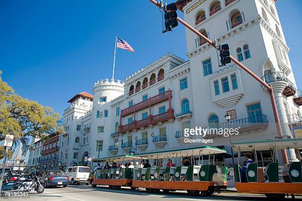 cable car in front of a building, st. augustine, florida, usa - st. augustine florida stock photos and pictures