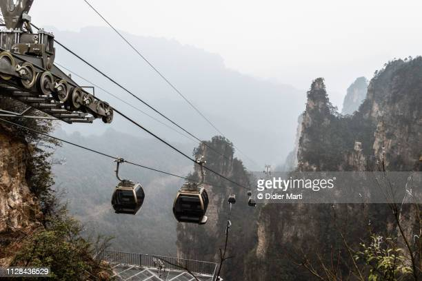 cable car in zhangjiajie in china - overhead cable car stock pictures, royalty-free photos & images