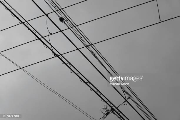 cable car lines below overcast sky - tokyo japan stock pictures, royalty-free photos & images