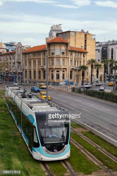 cable car moving next to car traffic on cumhuriyet boulevard near konak square,izmir. - emreturanphoto stock pictures, royalty-free photos & images