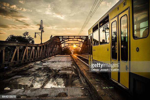 Cable Car On Railway Bridge Against Sky During Sunset