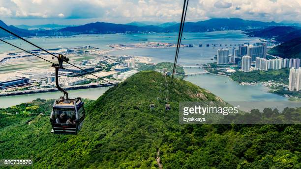 cable car over mountain in hong kong - lantau stock pictures, royalty-free photos & images