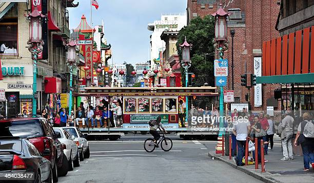 A cable car passes through San Francisco's Chinatown district