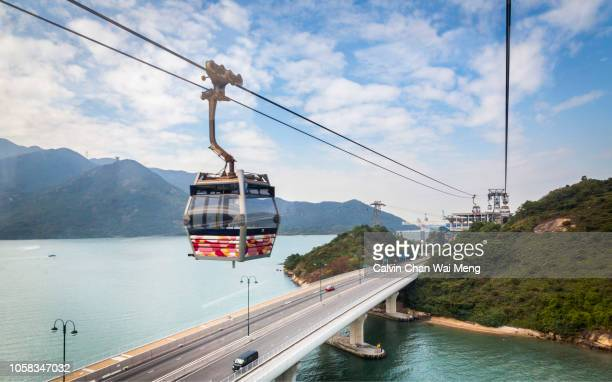 cable car ropeway to lamma island - overhead cable car stock pictures, royalty-free photos & images
