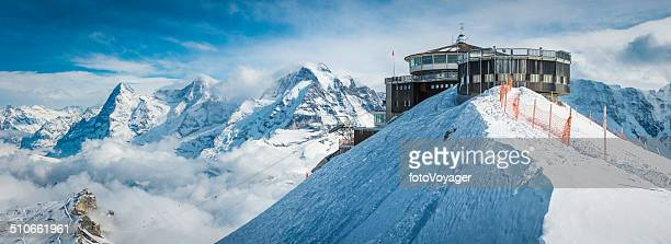 Cable car station on snowy mountain idyllic winter peak panorama