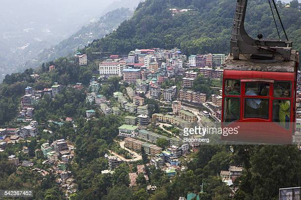 A cable car transports commuters along the Gangtok Ropeway above residential developments in Gangtok Sikkim India on Tuesday May 3 2016 For more than...