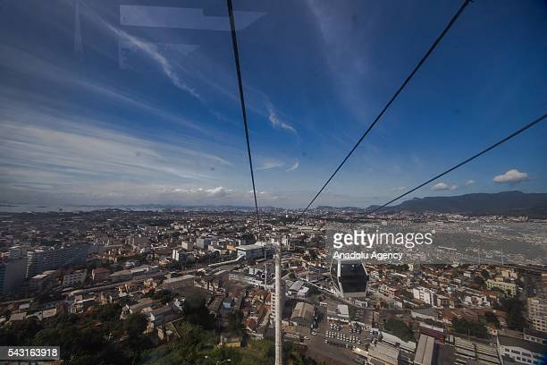 A cable car transports commuters over homes in the Alemao Complex Morro do Alemao is seen in Rio de Janeiro Brazil on June 26 2016