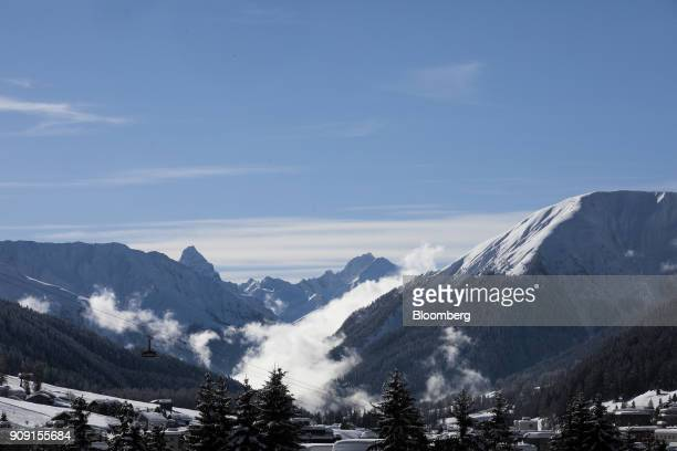 A cable car travels up a mountiain on the opening day of the World Economic Forum in Davos Switzerland on Tuesday Jan 23 2018 World leaders...