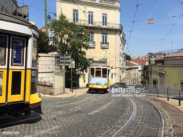Cable Cars In Street In City