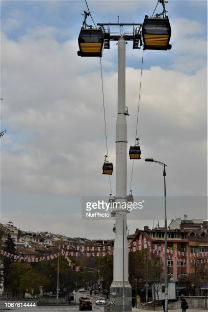 Cable cars move on the line between Yenimahalle and Sentepe districts in Ankara Turkey on December 2 2018 The cable car line between Yenimahalle and...