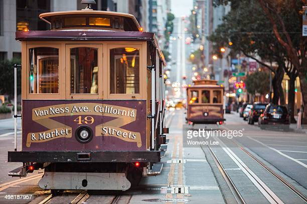 cable cars on city street, san francisco, california, usa - tram stockfoto's en -beelden