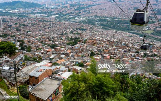 cable cars over medellin city with endless stream oh houses - antioquia stock pictures, royalty-free photos & images