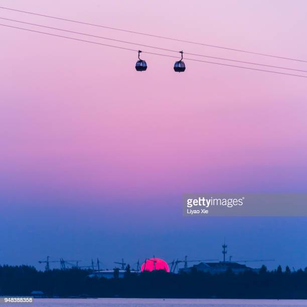 cable cars over the river - liyao xie stock pictures, royalty-free photos & images