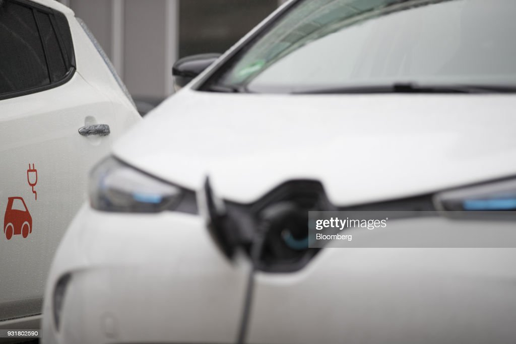 A cable charges an electric automobile at a charging station outside the headquarters of EON SE in Essen, Germany, on Tuesday, March 13, 2018. EON will shed as many as 5,000 jobs in the deal to take over Innogy SE, a move that marks the biggest shakeup in Germany's energy business in years. Photographer: Jasper Juinen/Bloomberg via Getty Images