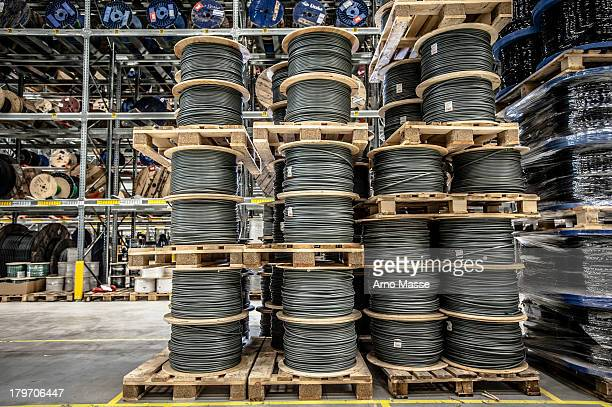 cable drums stacked on pallets in warehouse - imperial system fotografías e imágenes de stock