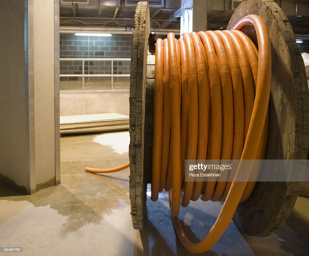 Cable for electric power supply on wooden spool. : Foto de stock
