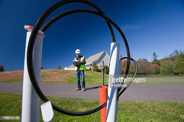 Cable installer working on wiring outside a house