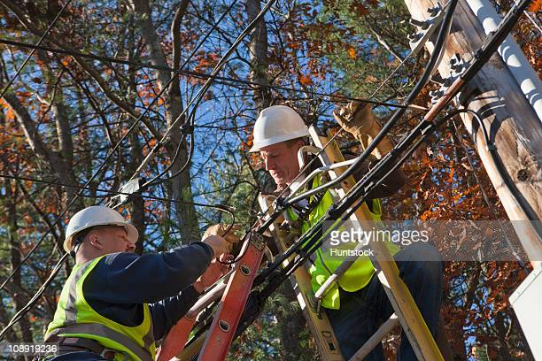 Cable installers installing cable for cable TV
