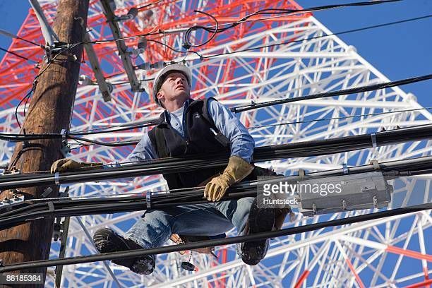 Cable lineman repairing transmission line